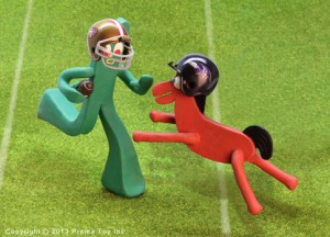 Gumby and Pokey playing football for the Superbowl