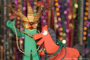 Gumby and Pokey with Mardi Gras beads