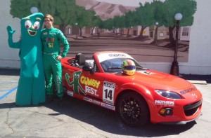 Kenton Koch with Gumby and his Gumby Fest race car, suit and helmet.