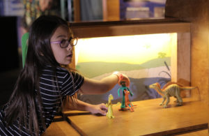 Girl doing stop motion animation with Gumby